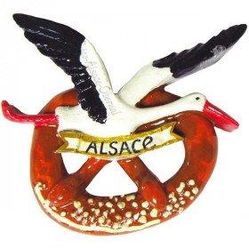 Magnet Décoratif Cigogne d'Alsace en vol sur sa Bretzel