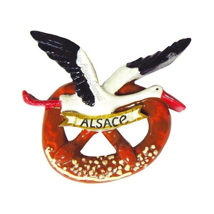 Retrouvez Magnet Décoratif Cigogne d'Alsace en vol sur sa Bretzel à Obernai