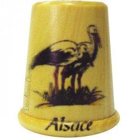 Dé à Coudre en Bois sérigraphié d'une Cigogne dans son nid et Alsace