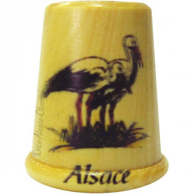Wooden thimble screen-printed with a Stork in its nest and Alsace