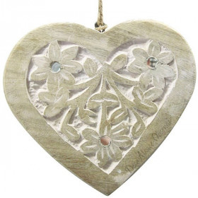 Solid wood heart carved on a white background decorated with mirrors
