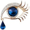 Golden fancy brooch in the shape of an eye set with rhinestones