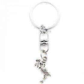 Metall-Schlüsselanhänger Mit einem Storch aus dem Elsass mit einem Baby in La